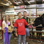 Jacob Campbell's grand champion dairy cheese basket fetched a $3,500 bid from Paris and Washington Insurance. Pictured from left are Junior Fair princess Brooke Bishop, Jacob Campbell and Paris and Washington representative Kelly Palmer.