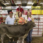 Brooke Bishop sold her 509-pound grand champion dairy feeder to John and Sally Deininger of Wooded View Farms for a record-setting $8.50 a pound.