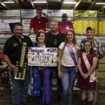 Eslich Wrecking bought Jessica Ruegg's 1,318-pound grand champion dairy steer carcass for $2 a pound.  Pictured from left are Rich Eislich, Sr.; Jessica Ruegg; Rich Eslich, Jr.; and fair royalty Brooke Bishop, Dean Rummell, and Anna Ramsey.
