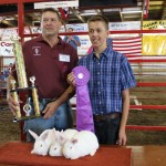Christian Pernell sold his pen of grand champion rabbits to Rohn Ranch Trailer sales for $350.  Pictured with Christian Pernell is Earl Rohn.