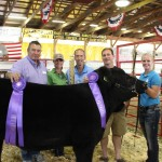 Grand champion exhibitor Lindsey Pugh sold her $1,343-pound market beef steer for a record-breaking bid of $20 per pound to Beaver Excavating Co., R.G. Smith Co., and Eslich Wrecking Company. Pictured with Lindsey Pugh are Richard Eslich, Sr., Anna Pugh, Dick Nicely, and John Eslich.