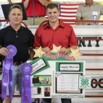 Logan Mercer fetched $3.25 a pound from Paris and Washington Insurance for his 1,197-pound grand champion market beef steer carcass. Pictured are Kelly Palmer of Paris and Washington Insurance and Logan Mercer.