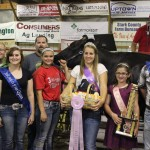 Cora Daniels' reserve champion dairy cheese basket was sold to Channel Seed and Paradise Valley Farms for $2,000.  Pictured are John Brookbank of Paradise Valley Farms, Junior fair queen Jessica Ruegg, Mike Ramsey of Channel Seed, Cora Daniel, and fair royalty Brooke Bishop, Anna Ramsey, and Dean Rummell.