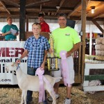 Bryce Snow's 68-pound reserve champion dairy wether was purchased by PSC Metals for $5 a pound.  Pictured with Bryce Snow is David Casalinova of PSC Metals.