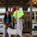 Adriana Grimm's 84-pound reserve champion market wether fetched a $12 a pound bid from PSC Metals. Pictured with Andriana Grimm is David Casalinova of PSC Metals.