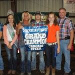Alexa Baker's grand champion carcass steer sold for $3.50 a pound to the Pidgeon Family Farm, represented by Sharon, Taylor, and Tarry Pidgeon.