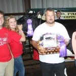 Autumn Whiteleather (at halter) sold her grand champion cheese basket for $3,250 to Nutri-Plus Fertilizer, Hubner Seeds, and John Griffith Milk Transport, represented by Ed Monter. Also pictured are Minerva Dairy President Adam Mueller (left) and 4-H Queen Courtney Hephner.