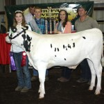 Deerfield Farms Service, represented by Bill Meier, paid $6 a pound for Sara Fraser's 542-pound grand champion dairy beef feeder. Also pictured are 4-H royalty James Kataro II and Courtney Hephner.