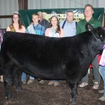 Mackenzie Kiko's 1,295-pound grand champion steer sold for $6.50 a pound to Paris Washington Insurance.