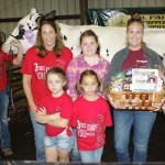 Consumers National Bank, represented by Sarah Chronister (with basket), paid $1,400 for Alexa Bates' reserve champion cheese basket. Also pictured are Minerva Dairy's Venae Watts, Jena Wright, Cadie Watts, and Olivia Hippely, representing trophy donor Fred and Susan Hippely.