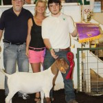 Devon Kitko's 66-pound grand champion goat sold for $22 a pound to Green Family Funeral Home, represented by Nancy Caldwell and Dave Green.