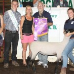 Cailee Rendlesham's 136-pound grand champion lamb sold for $7 a pound to Green Family Funeral Home, represented by Nancy Caldwell and Dave Green.