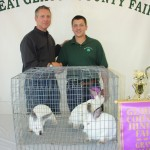 Ryan Ivans sold his grand champion pen of rabbits weighing 13.20 pounds to John Bruening of Geauga Vision for $85 a pound.