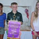 Dennis Bergansky sold his 51-pound grand champion turkey to Mangia, Mangia, represented by Isabella Harton and Halley Ledbetter, for $25 a pound.
