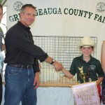 Geauga Vision, represented by John Bruening, paid $35 a  pound for Samantha Bergansky's reserve champion pen of chickens weighing 33.90 pounds.