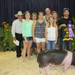 Bailey Kasbee's 262-pound grand champion hog sold for $21 a pound to Miller's Auction and the Area Shopper, represented by (from left) Simon Miller, Morgan Miller, Paula Miller, Mackenzie Miller, Brian Miller, Marissa Miller and Matt Miller.