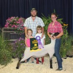 Cassidy Gadsby's 120-pound grand champion lamb sold for $6.75 a pound to Mowry Auction Services, represented by Chuck Mowry, and Brenna and Grace Mowry.
