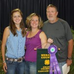Lauren Steele raised the 61-pound grand champion carcass lamb, which sold for $8 a pound to Newton Financial, represented by Lynne and Harold Newton.