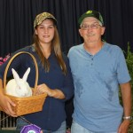 Miranda Lattyak's grand champion meat rabbit sold for $75 to Cope Equipment, represented by Earl Fenton.