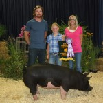 Howard and Son Meat Packing and DJ's Smokehouse, represented by DJ and Theresa Howard, paid $3 a pound for Leah Hostetler's 283-pound reserve champion hog.