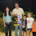 Blair Ellen Steele's 74-pound reserve champion carcass lamb sold for $10 a pound to Whispering Pines Veterinary Services, represented by Matt Miller, and Grayson, Bayleigh and Reagan Miller.