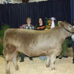 Courtnie Roberts sold her 1,332-pound reserve champion steer for $2.70 a pound to Wagler's Camp Perry, represented by Hunter and Brina Wagler.